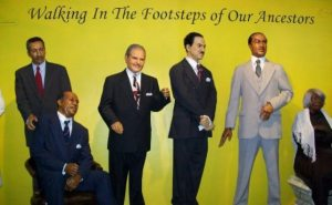 group-of-black-wax-figures